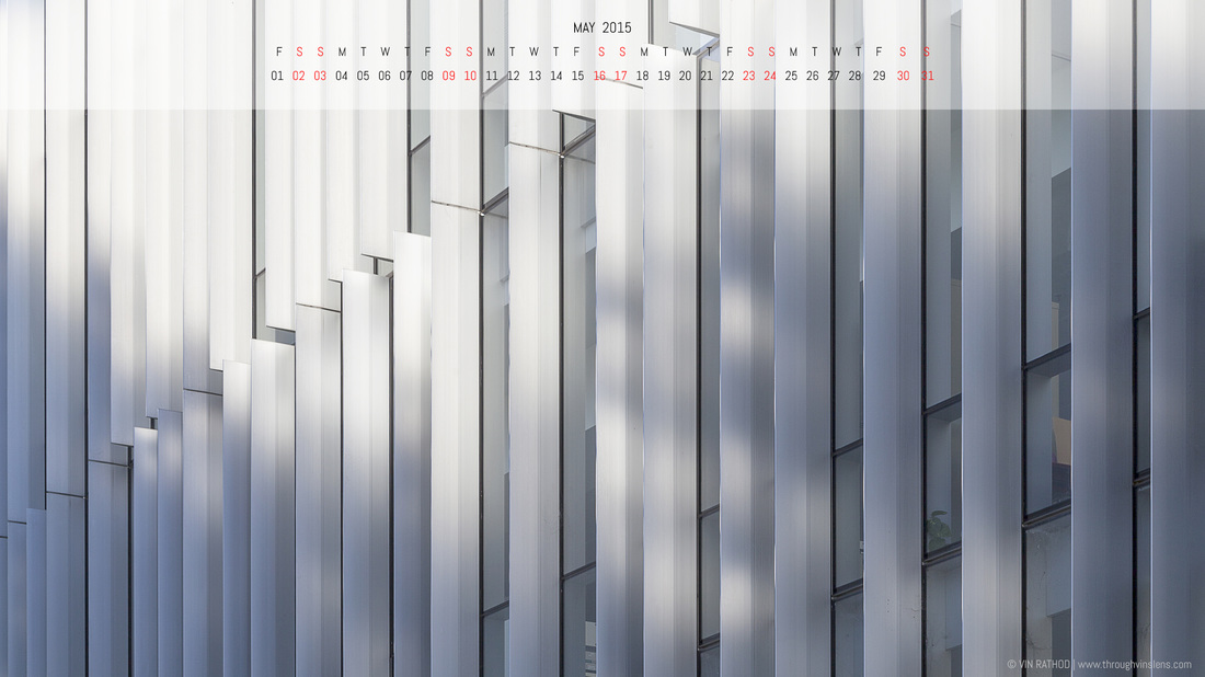 Geometric abstract architecture photograph of an urban building in white with May 2015 calendar. Can be used for desktop wallpaper