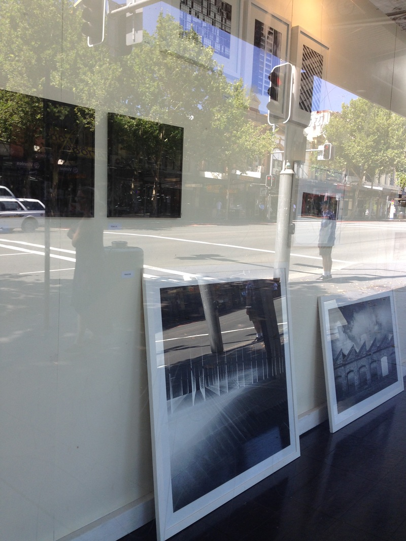 Exhibition from street showing balck and white fine art photos of architecture