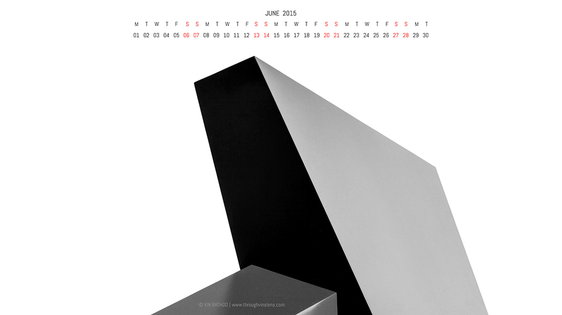 Abstract black and white photograph of an art installation that looks like a building. Art meets architecture here. It has June 2015 Calendar and can be used as desktop calendar