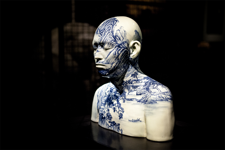 Sculpture on man, white in colour with blue printed design