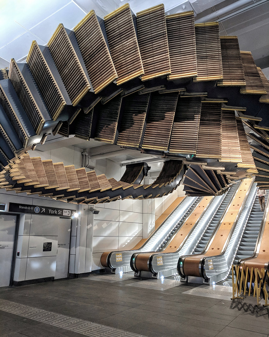Old escalators being suspended in form of an artwork at Sydney's Wynyard station