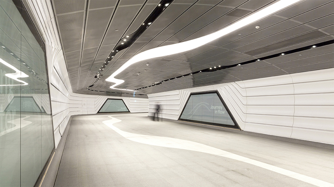 Image of tunnel connecting Barangaroo and Wynyard station showing play of light and lines in architecture i
