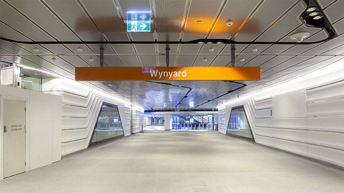Entry to Wynyard Walk showing display panels on walls and ticket machines in front